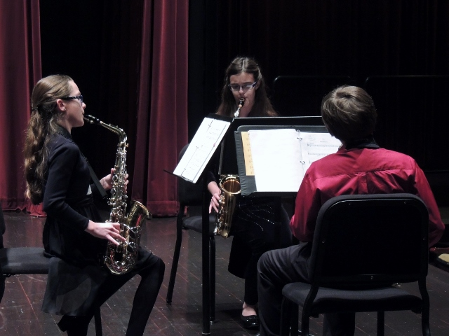Students playing the saxaphone