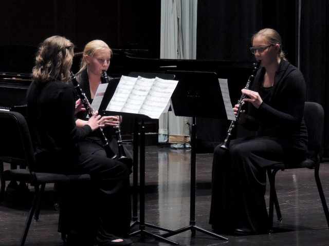 Students playing clarinet
