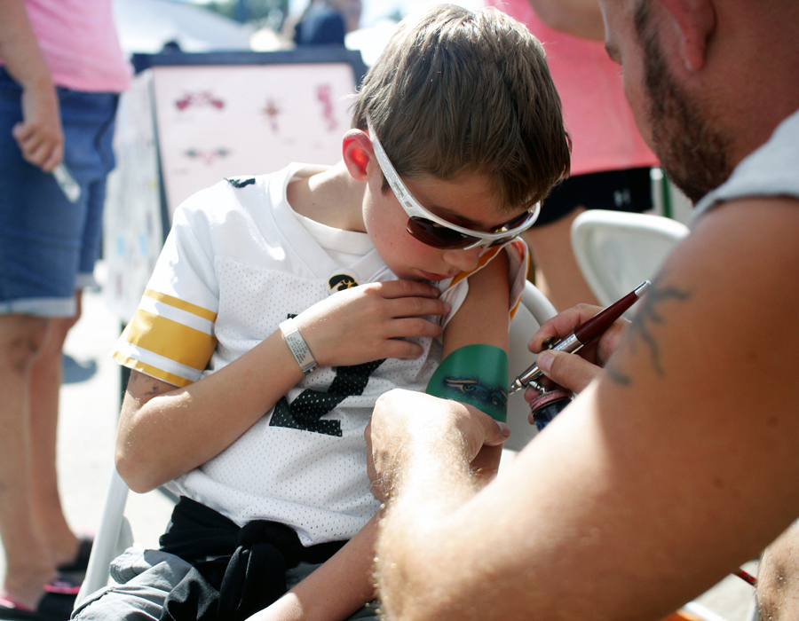 Child getting an airbrush tattoo