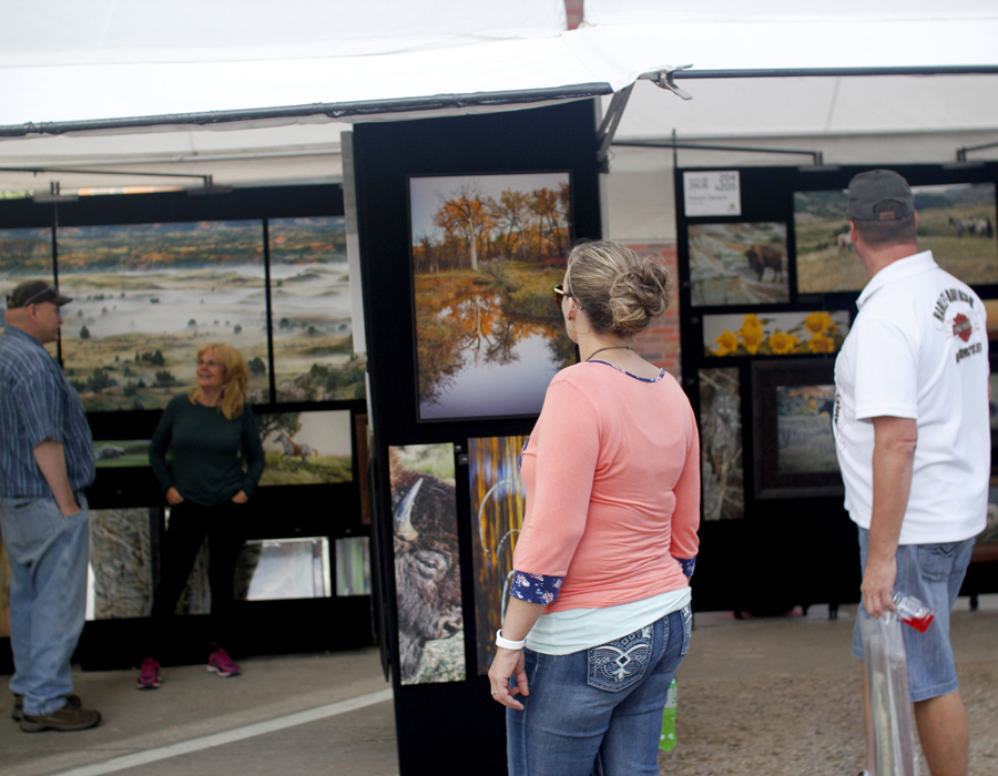 SWAF attendees browsing an art booth