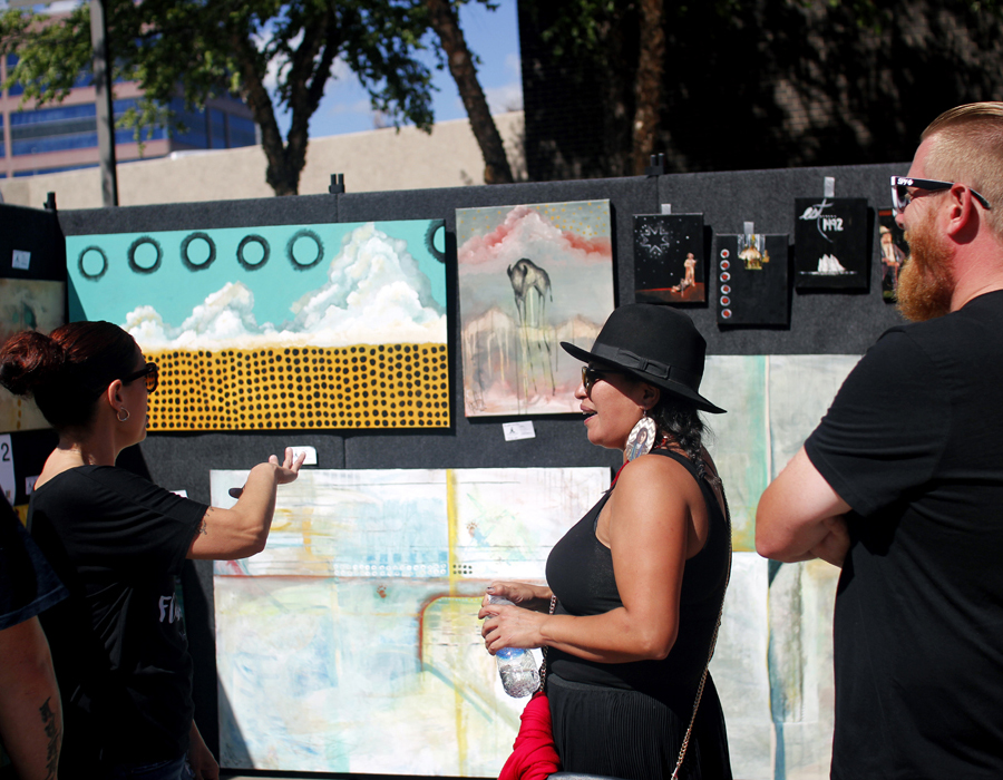 SWAF attendees browsing a canvas art booth
